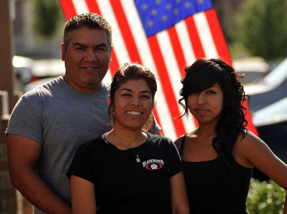 George Nolasco, with his wife, Hortencia and daughter, Yuliana, has gone through a process to get Hortencia, who entered the country illegally, legal residency through a process available to active-duty military members. Photo: Robin Jerstad / Special To The Express-News