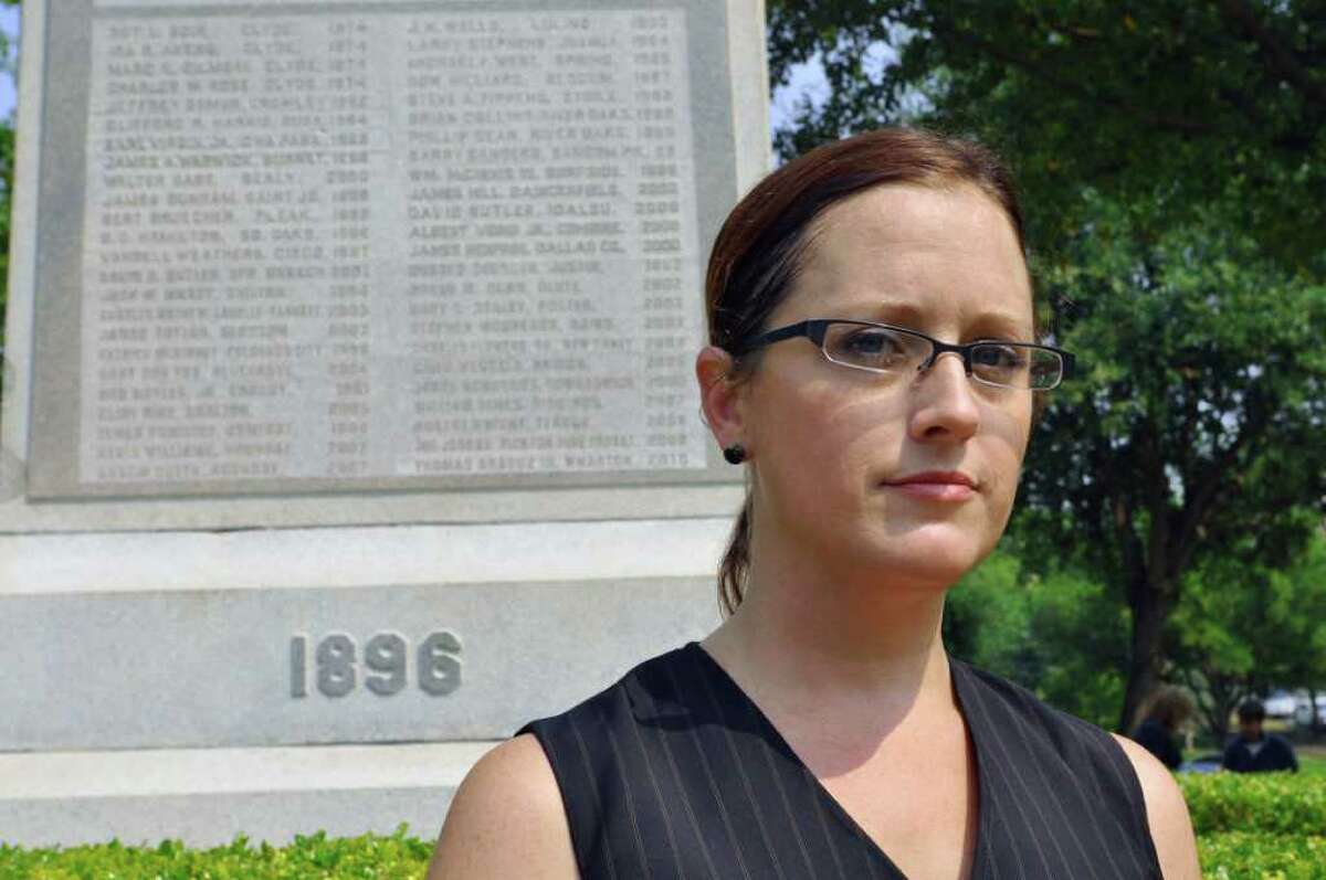 Nikki Araguz stands in front of a monument to fallen volunteer firefighters in Austin on April 20. Araguz is a transgendered woman whose husband died while fighting a fire in Wharton County in 2010, and she now faces a lawsuit claiming her marriage was not valid. Two Texas lawmakers have introduced legislation that would repeal a state law that recognized transgender marriages in 2009. (AP Photo/ Chris Tomlinson)