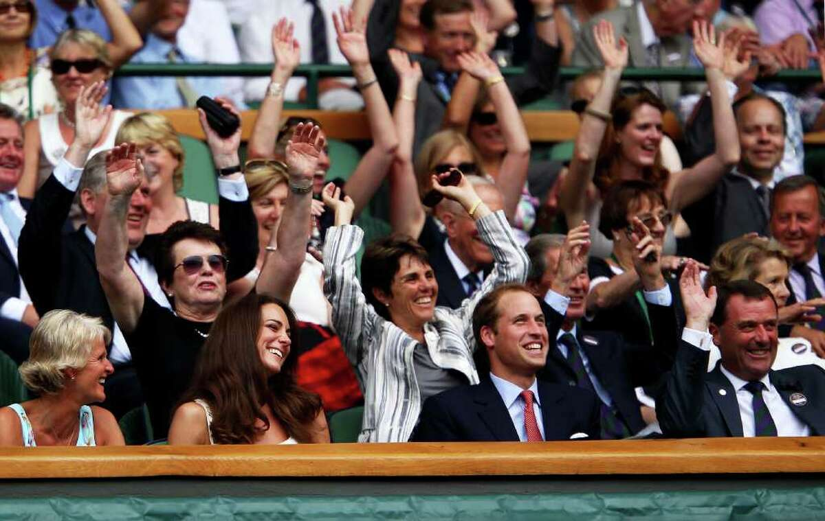 LONDON, ENGLAND - JUNE 27: Billie Jean King, Catherine, Duchess of Cambridge and Prince William, Duke of Cambridge and Chairman of the All England Lawn Tennis Club Philip Brook participate in the wave during the fourth round match between Rafael Nadal of Spain and Juan Martin Del Potro of Argentina on Day Seven of the Wimbledon Lawn Tennis Championships at the All England Lawn Tennis and Croquet Club on June 27, 2011 in London, England. (Photo by Clive Brunskill/Getty Images)