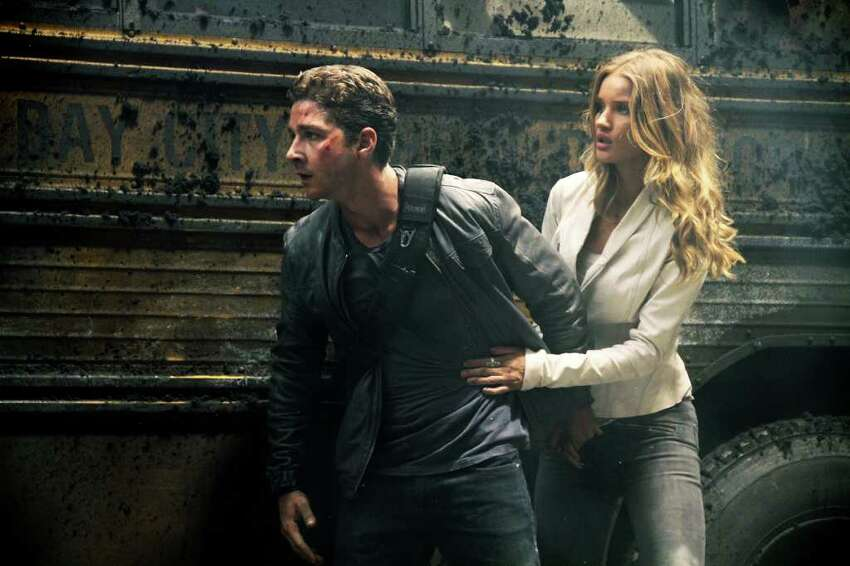 In this publicity image released by Paramount Pictures, Shia LaBeouf plays Sam Witwicky, left, and Rosie Huntington-Whiteley plays Carly in a scene from