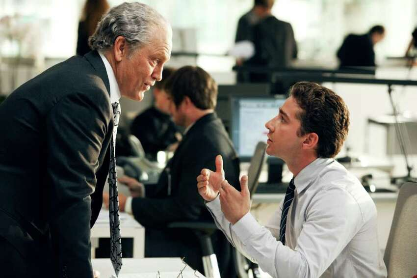 In this publicity image released by Paramount Pictures, John Malkovich plays Bruce Brazos, left, and Shia LaBeouf plays Sam Witwicky in a scene from