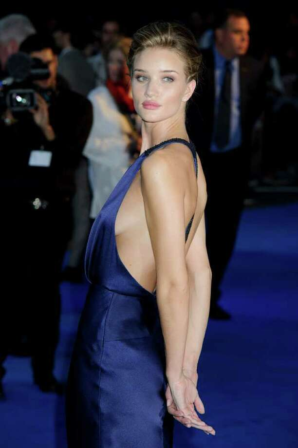 British actress, Rosie Huntington Whiteley, arrives for the UK Premiere of Transformers: Dark Of The Moon, at a central London venue, Sunday, June 26, 2011. Photo: Jonathan Short, AP / AP