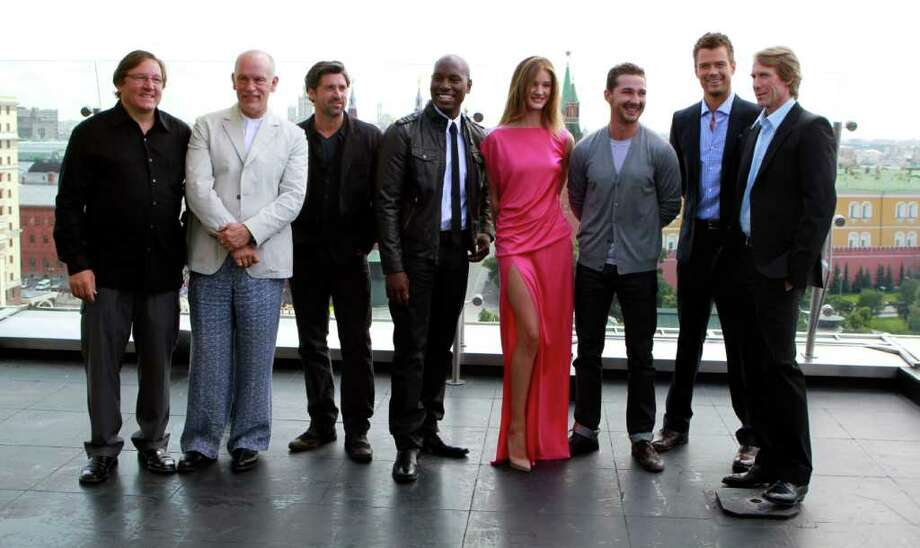 From left, producer Lorenzo di Bonaventura, John Malkovich, Patrick Dempsey, Tyrese Gibson, Rosie Huntington-Whiteley, Shia LaBeouf, Josh Duhamel, and director Michael Bay pose during a photo call for the world premiere of Hollywood blockbuster Transformers: Dark of the Moon, in Moscow, Thursday, June 23, 2011. Photo: Yury Samolygo, AP / AP