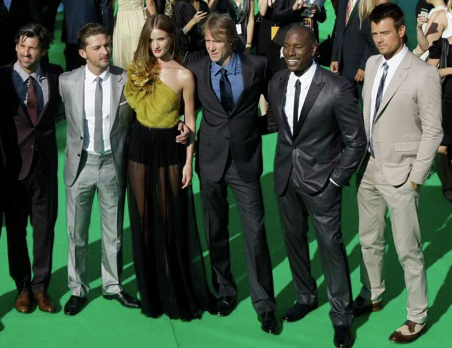 From left, Actor Patrick Dempsey, Actor Shia LaBeouf, Actress Rosie Huntington-Whiteley, Filmmaker Michael Bay, Tyrese Gibson, Josh Duhamel, pose at the opening ceremony of the Moscow international film festival in Moscow, Russia, Thursday, June 23, 2011. The Moscow Film Festival opened with Hollywood blockbuster Transformers: Dark of the Moon. Photo: Misha Japaridze, AP / AP