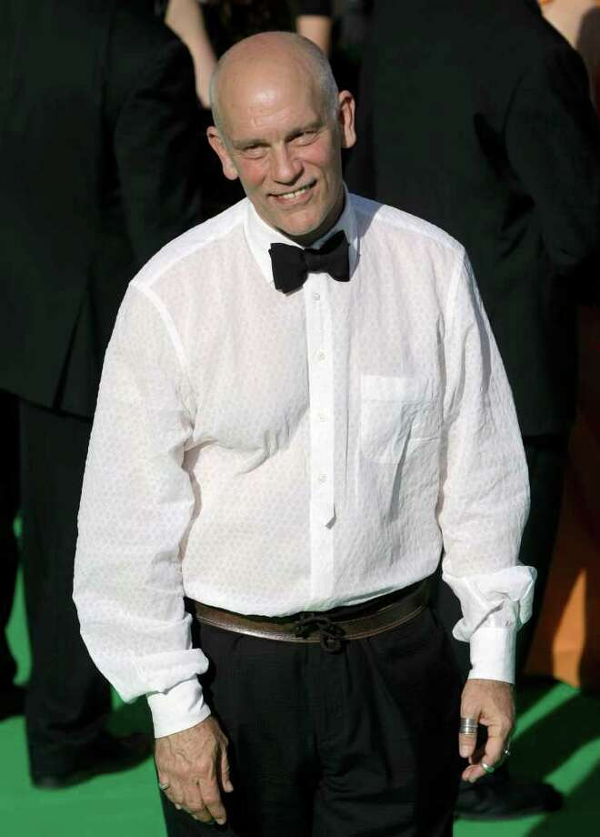 U.S. actor John Malkovich poses at the opening ceremony of the Moscow international film festival in Moscow, Russia, Thursday, June 23, 2011. The Moscow Film Festival opened with Hollywood blockbuster Transformers: Dark of the Moon. Photo: Misha Japaridze, AP / AP