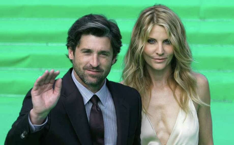 Actor Patrick Dempsey, left, and an unidentified woman, pose at the opening ceremony of the Moscow international film festival in Moscow, Russia, Thursday, June 23, 2011. The Moscow Film Festival opened with Hollywood blockbuster Transformers: Dark of the Moon. Photo: Misha Japaridze, AP / AP