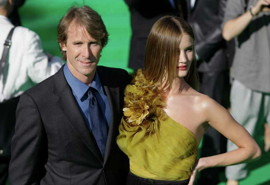 Filmmaker Michael Bay, left, and Actress Rosie Huntington-Whiteley pose at the opening ceremony of the Moscow international film festival in Moscow, Russia, Thursday, June 23, 2011. The Moscow Film Festival opened with Hollywood blockbuster Transformers: Dark of the Moon. Photo: Misha Japaridze, AP / AP