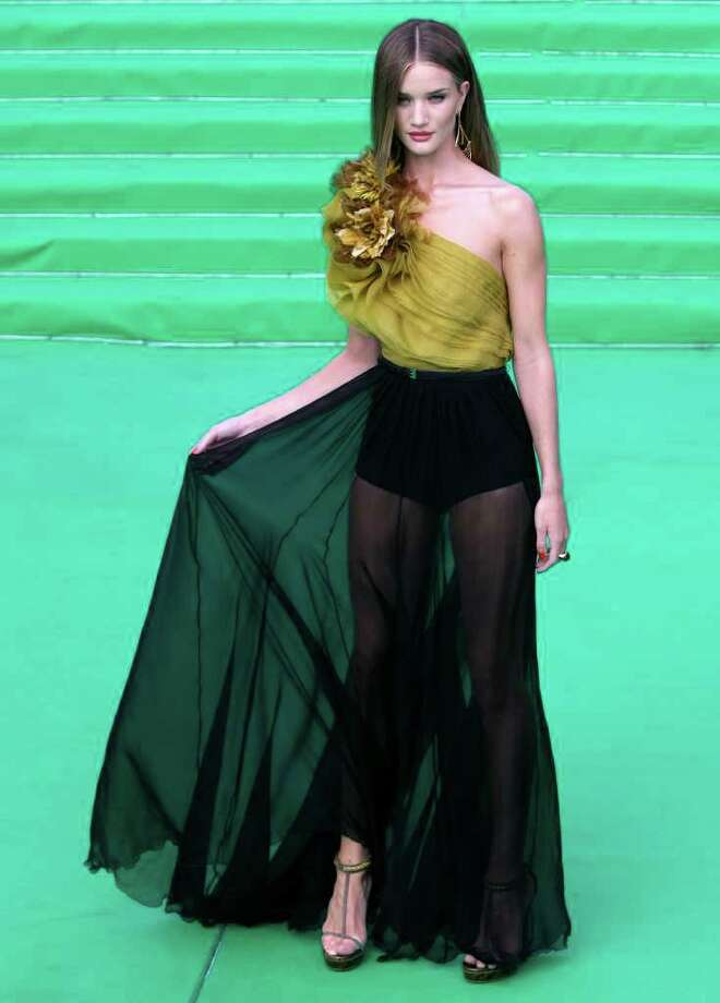 Actress Rosie Huntington-Whiteley poses at the opening ceremony of the Moscow international film festival in Moscow, Russia, Thursday, June 23, 2011. The Moscow Film Festival opened with Hollywood blockbuster Transformers: Dark of the Moon. Photo: Misha Japaridze, AP / AP