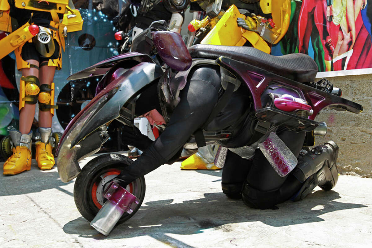 Jessica Legorreta, 29, poses wearing her self-made RC Transformer motorcycle costume at her home in a working class neighborhood in Mexico City, Wednesday, June 8, 2011. Legorreta whose daytime job is an industrial designer, is, along with her husband, an avid cosplayer and cosmaker, a type of performance art in which participants don and make costumes and accessories to represent a specific character. Their characters of choice are the Transformers and the Star Wars characters.