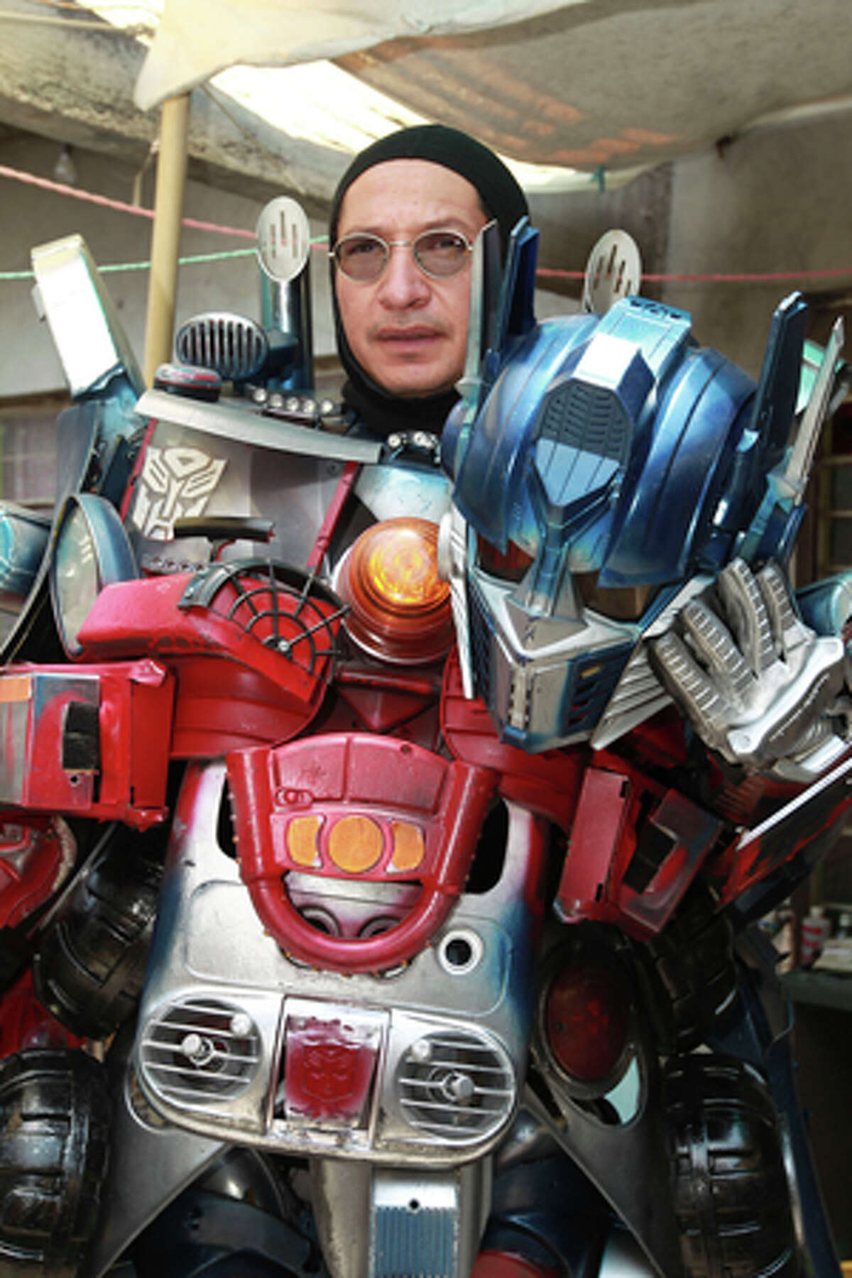 Jose Luis Mendez Luna, 38, poses wearing his Optimus Prime Transformer costume at home in a working class neighborhood in Mexico City, Wednesday, June 8, 2011. Luna whose daytime job is a plumber, is, along with his wife, both avid cosplayer and cosmakers, a type of performance art in which participants don and make costumes and accessories to represent a specific character. Their characters of choice are the Transformers and the Star Wars characters.