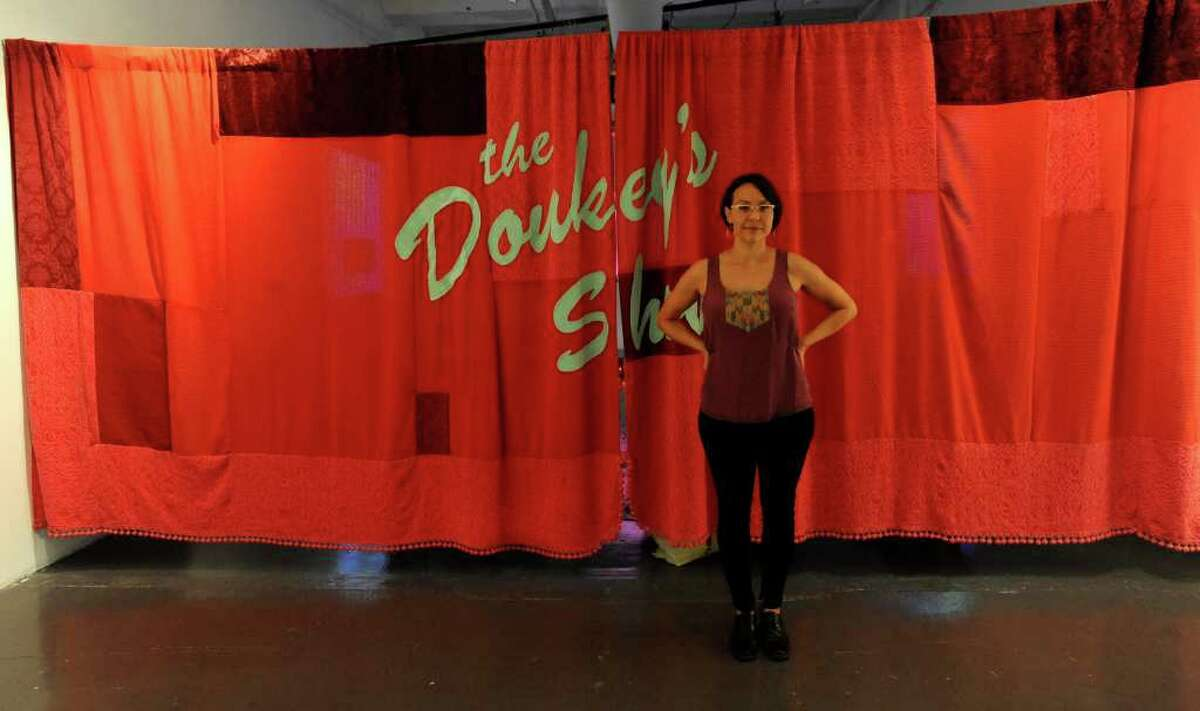Artist Julia Barbosa Landois stands by a curtain in her installation at the Blue Star Contemporary Space. June 17, 2011. BILLY CALZADA / gcalzada@express-news.net vincent t. davis story