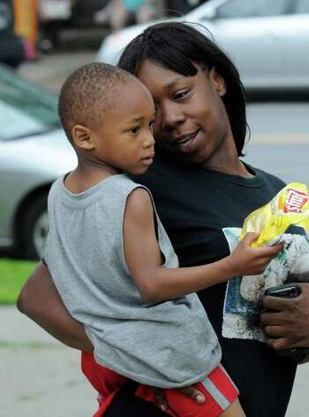 Dymere A. Johnson, 3, is securely in the arms of his mother, Chante Coleman, Tuesday afternoon as they leave Albany Police Department's Center Station.  Dymere was missing for several hours Tuesday.  (Skip Dickstein / Times Union) Photo: SKIP DICKSTEIN