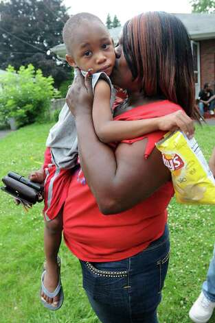 Tracy Coleman of Albany hugs her grandson Dymere Johnson moments after police bring him home after he was reported missing Tuesday morning in the Pine Hills neighborhood.  (Lori Van Buren / Times Union) Photo: Lori Van Buren