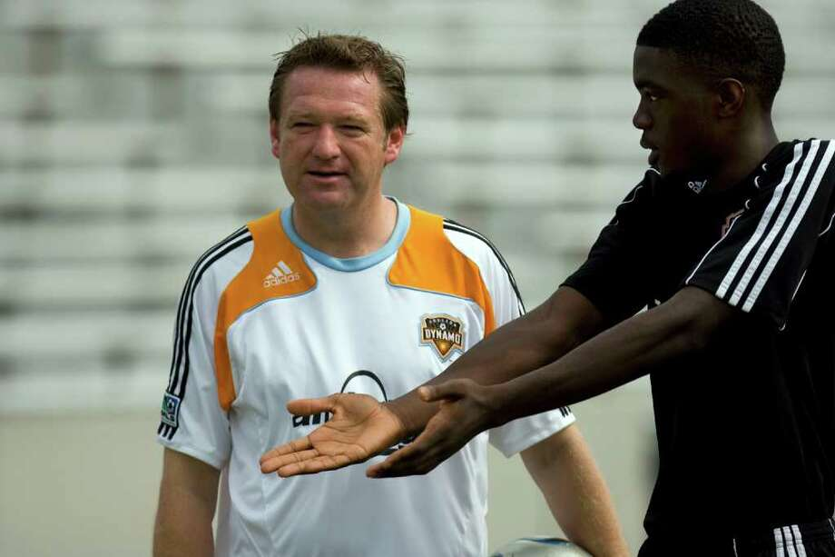 Sebastien Ibeagha, who was just signed by the Dynamo, talks with James Clarkson, the  Dynamo director of youth development, in 2009 when Ibeagha was a member of the Dynamo Academy. Photo: Johnny Hanson, Staff / Houston Chronicle