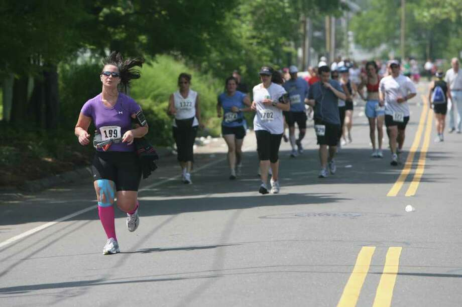 Runners compete in the The Stratton Faxon Fairfield Half Marathon on Sunday, June 26, 2011. Photo: B.K. Angeletti / Connecticut Post