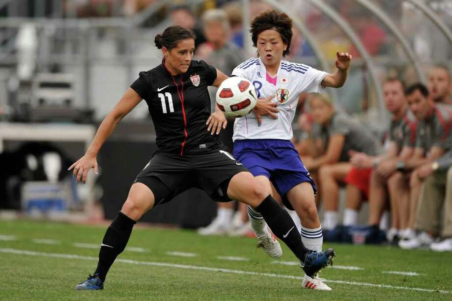 Ali Krieger (left) of the United States battle for control of the ball with Aya Miyama of Japan on May 14, 2011 at Crew Stadium in Columbus, Ohio. Photo: Jamie Sabau, Getty Images / 2011 Getty Images
