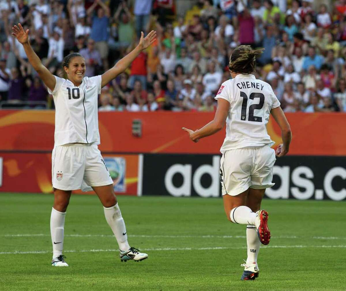 Lauren Cheney of the U.S.(right) celebrates the first goal with teammate Carli Lloyd during the FIFA Women's World Cup Group C match between USA and North Korea at Rudolf-Harbig-Stadion on June 28, 2011 in Dresden, Germany.