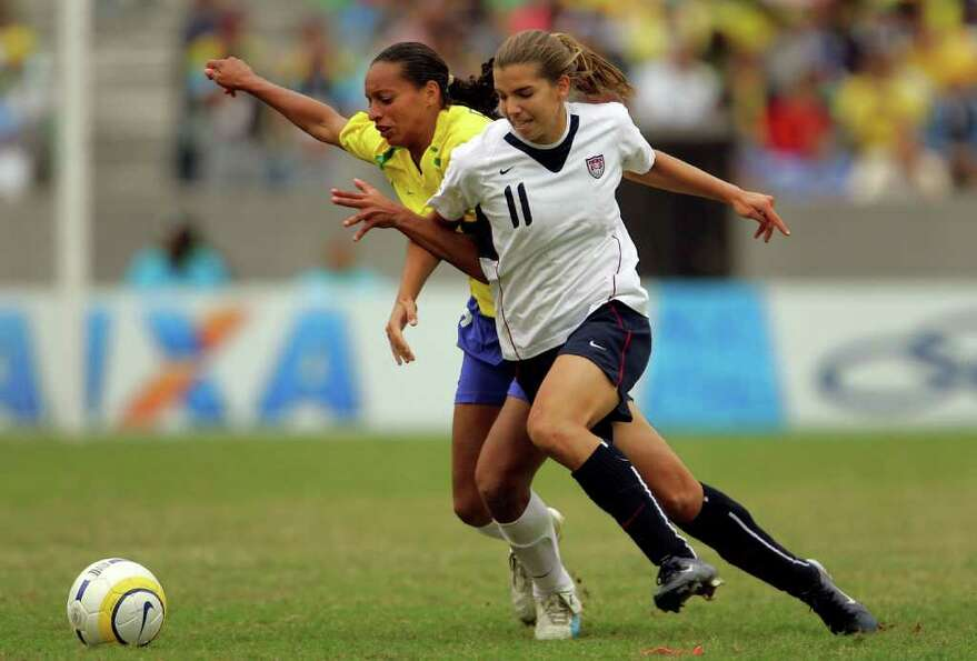 Tobin Heath (right) of the United States of America and Rosana Augusto of Brazil battle for the ball