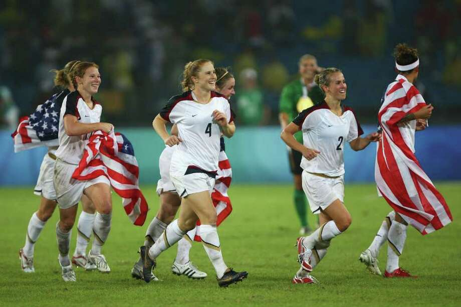 The United States team celebrates after winning the Women's Football Gold Medal match between Brazil and the United States 0-1 on Day 13 of the Beijing 2008 Olympic Games on August 21, 2008 at Worker's Stadium in Beijing, China. Photo: Mike Hewitt, Getty Images / 2008 Getty Images