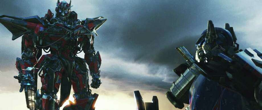 (Left to right) Sentinel Prime and Optimus Prime in TRANSFORMERS: DARK OF THE MOON, from Paramount Pictures.   Photo credit: Courtesy of Paramount Pictures Photo: Photo Credit: Courtesy Of Paramo