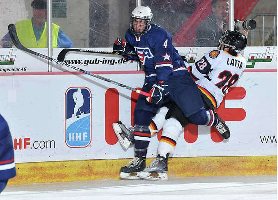 Westporter Mike Paliotta delivers a check while playing the US National U-18 team hockey, who won the gold medal at the U-18 world championship in Germany. Paliotta was drafted in the third round by the Chicago Blackhawks Saturday. Photo: Contributed Photo