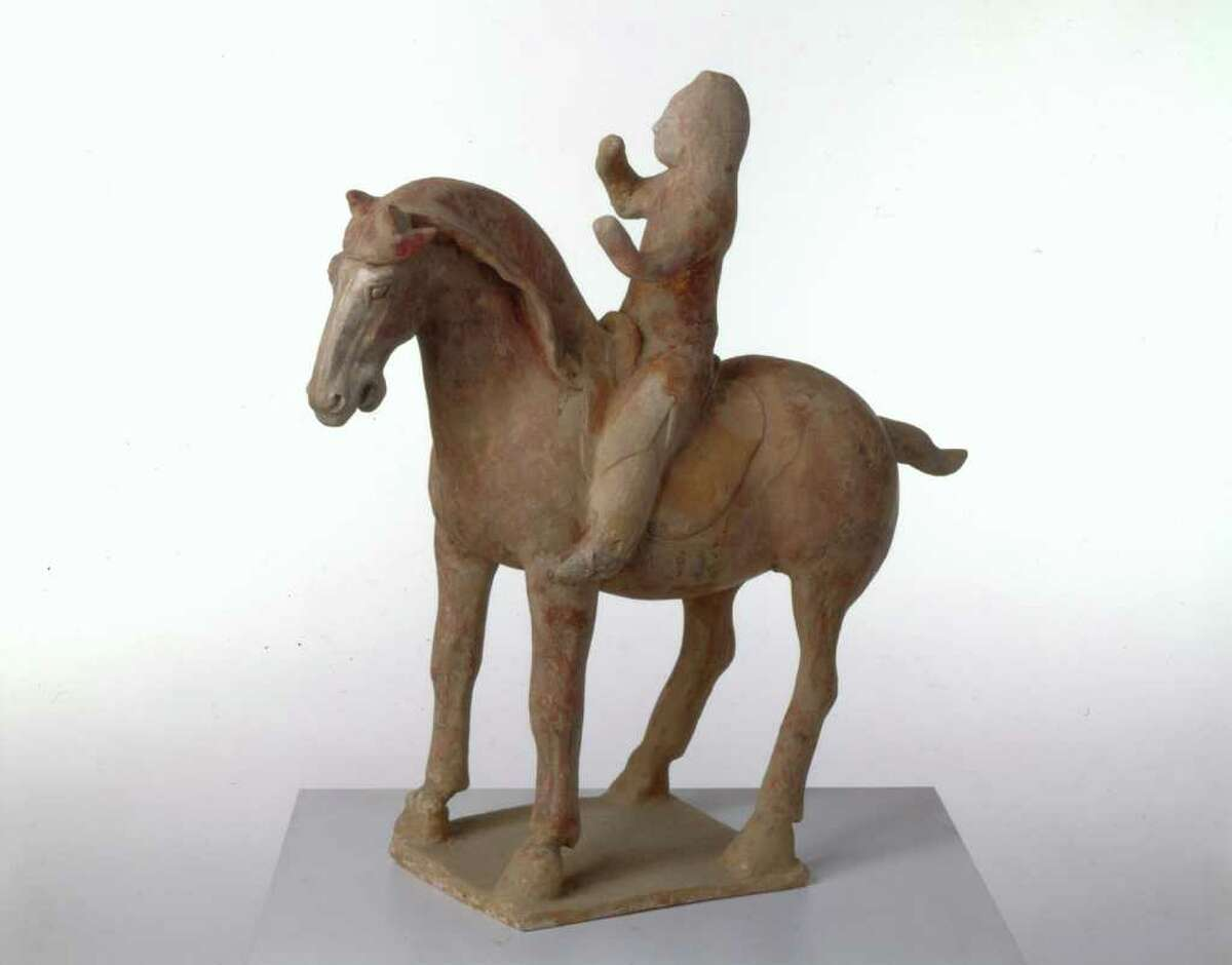 """Horse and Rider, a piece of unglazed pottery from the Tang Dynasty, 618-907 CE, is among the works on display in """"Saddle Up! Horsing Around at the Bruce Museum."""""""
