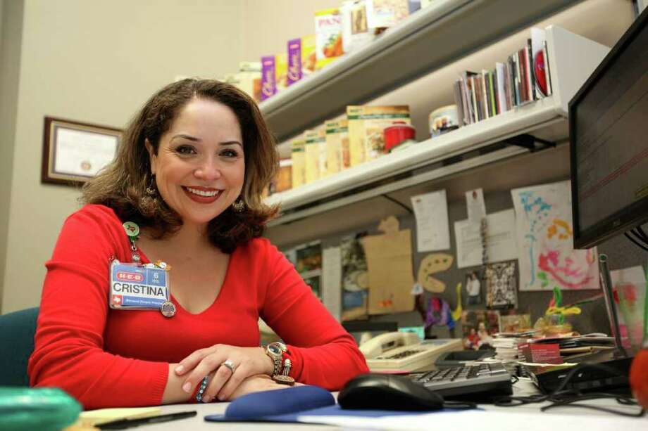 "Cristina Peña Walls, global sourcing team leader for H-E-B, in her office at the company's headquarters, calls her team ""cultural interpreters."" Photo: ANDREW BUCKLEY, SAN ANTONIO EXPRESS-NEWS / SAN ANTONIO EXPRESS-NEWS"