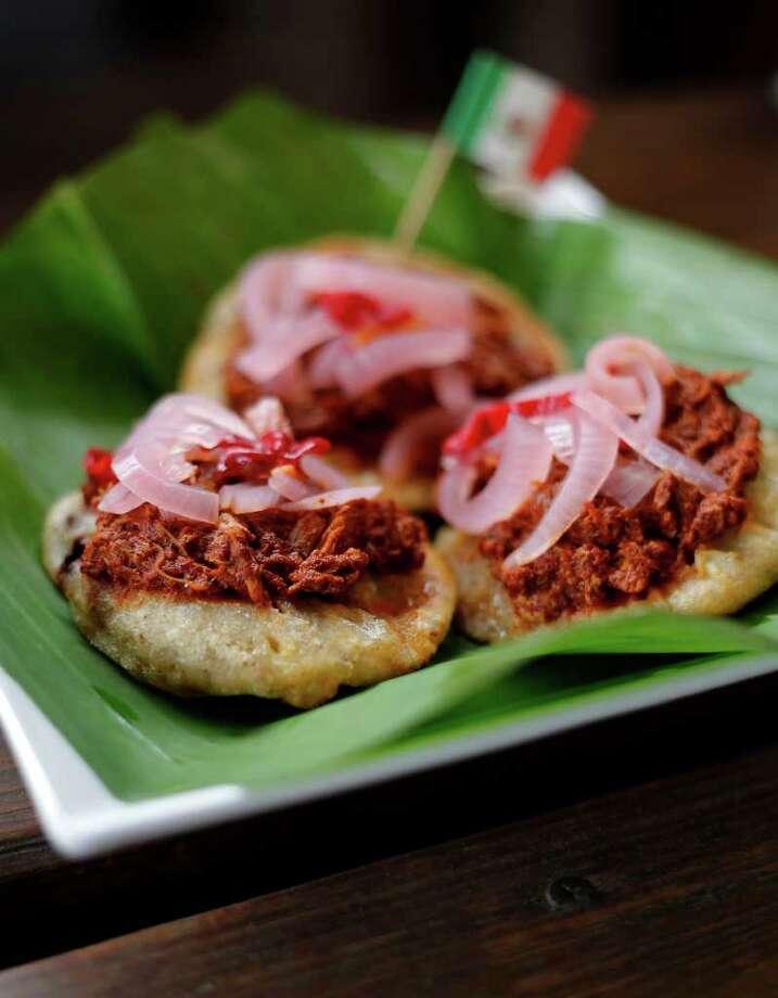 El Taco y La Tequila serves panuchos de cochinita, made with black beans, pork, chicken and achiote sauce. The dishes are in the style of chef Jaime Trueba's home state of Veracruz. Photo: KIN MAN HUI, SAN ANTONIO EXPRESS-NEWS / San Antonio Express-News