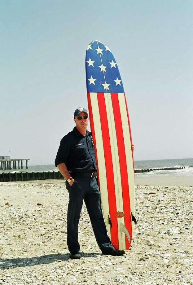 Robert Carley caught up with this firefighter/surfer in Atlantic City, N.J. Photo: Contributed Photo / Greenwich Citizen