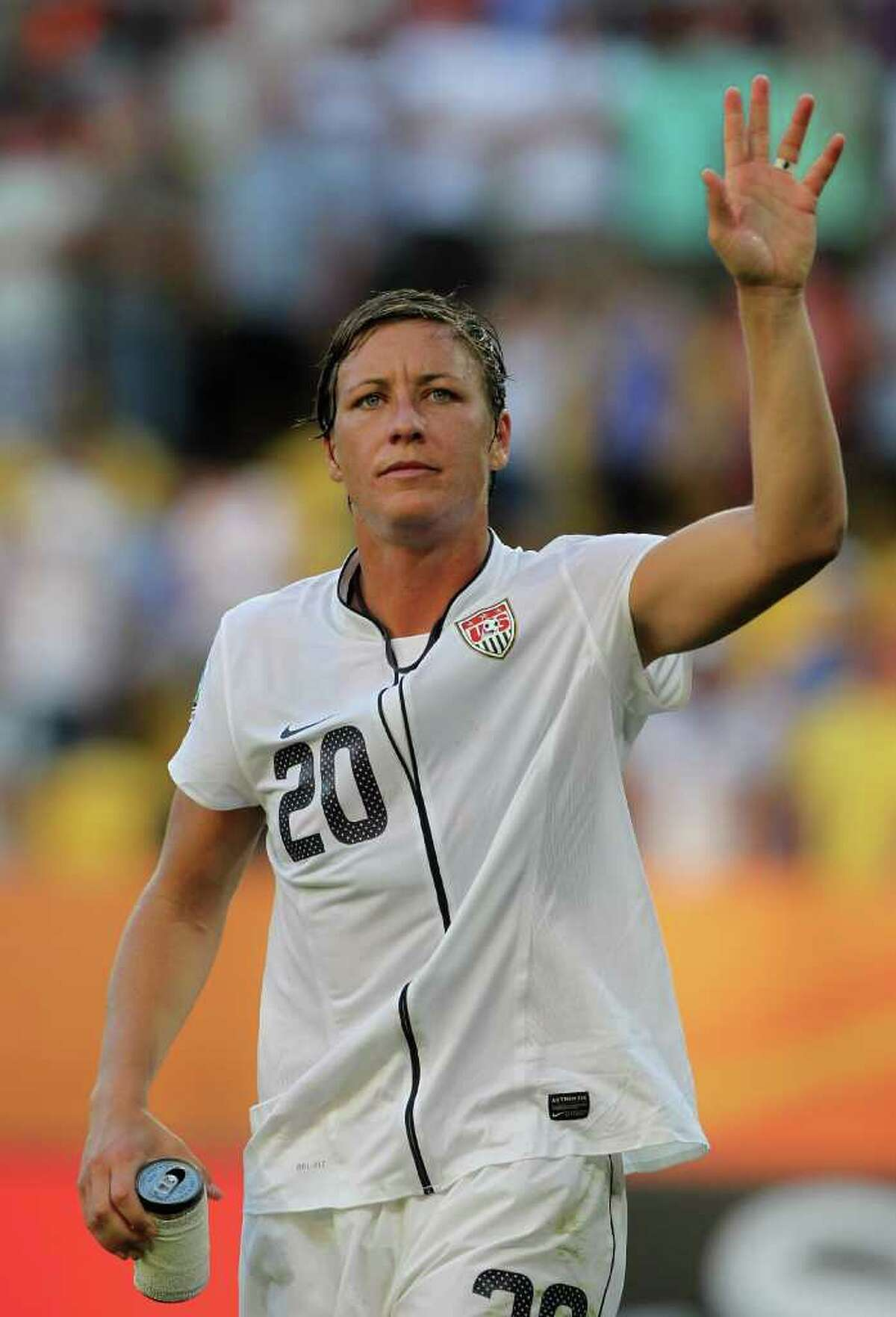 DRESDEN, GERMANY - JUNE 28: Abby Wambach of USA waves to her fans after winning the FIFA Women's World Cup Group C match between USA and Korea at Rudolf-Harbig-Stadion on June 28, 2011 in Dresden, Germany. (Photo by Boris Streubel/Getty Images)