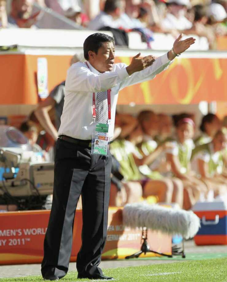 DRESDEN, GERMANY - JUNE 28:  Kwang Min Kim, head coach of Korea DPR gestures during the FIFA Women's World Cup Group C match between USA and Korea at Rudolf-Harbig-Stadion on June 28, 2011 in Dresden, Germany.  (Photo by Boris Streubel/Getty Images) Photo: Boris Streubel, Getty Images / 2011 Getty Images