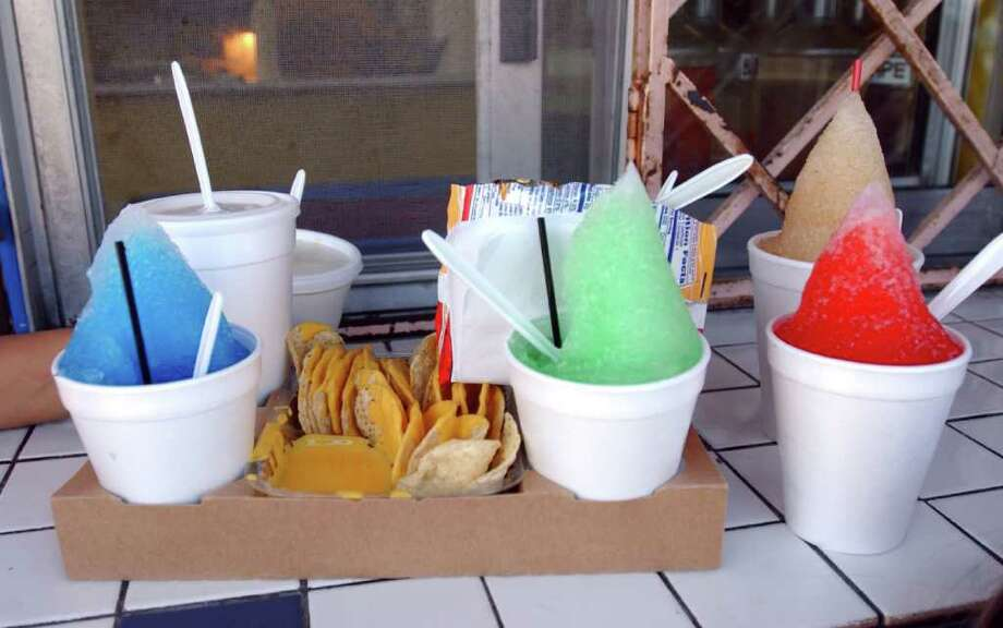 You'd never use a spoon to eat a raspa, unless you were a tourist, of course.  Photo: Karen Warren, Staff / Houston Chronicle