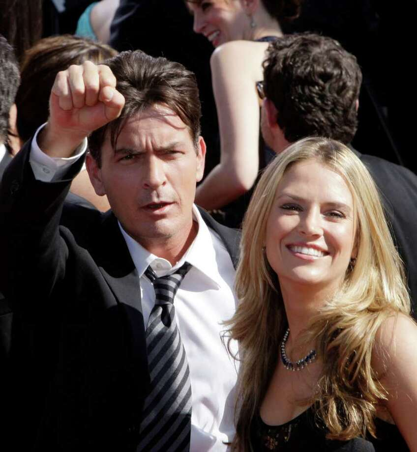 FILE - This May 30, 2008 file photo shows actor Charlie Sheen and Brooke Mueller arriving at the 59th Primetime Emmy Awards in Los Angeles. Mueller is asking Sheen's ex-bosses to withhold $55,000 a month in child support from any payments they make to the actor. (AP Photo/Kevork Djansezian, file) Photo: Kevork Djansezian