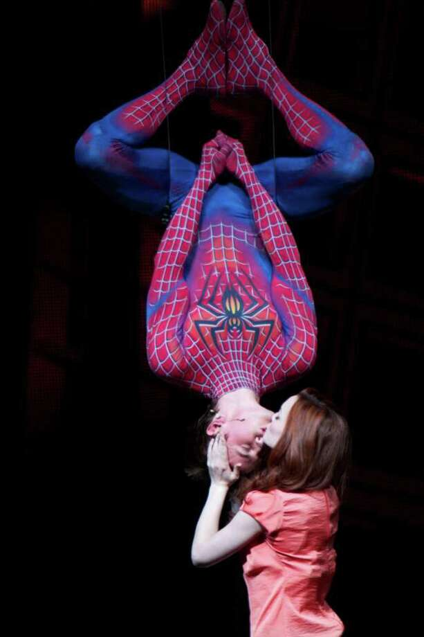 """In this theater publicity image released by The O&M Co., Reeve Carney and Jennifer Damiano are shown in a scene from """"Spider-Man: Turn Off The Dark."""" The reboot of the """"Spider-Man"""" musical on Broadway enjoyed a strong second straight week at the box office, leaving the two lead producers cautiously optimistic about the future of the show.""""Spider-Man: Turn Off the Dark"""" took in $1.7 million for the week ending Sunday, June 26. (AP Photo/The O&M Co., Jacob Cohl) Photo: Jacob Cohl"""