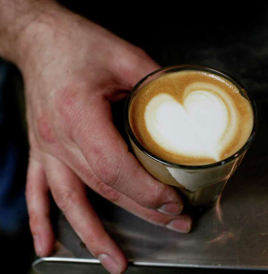 Aaron Blanco, owner of The Brown Coffee Co., 1702 W. Kings Hwy., displays a Cortave, made with espresso, agave nectar and milk, he made for a customer in San Antonio on Saturday, April 3, 2010. Photo: LISA KRANTZ, SAN ANTONIO EXPRESS-NEWS / SAN ANTONIO EXPRESS-NEWS