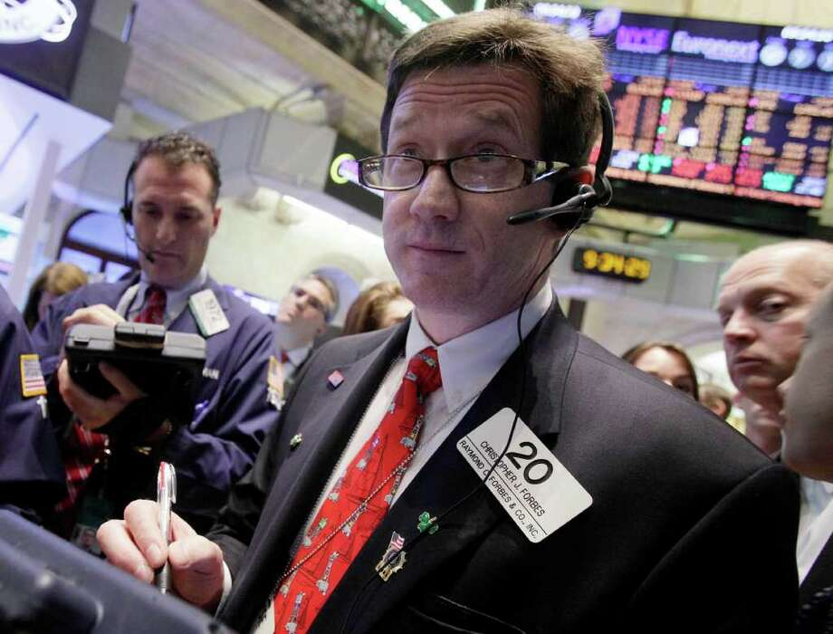 In this June 22, 2011 photo, trader Christopher Forbes, center, works on the floor of the New York Stock Exchange. World stock markets edged higher Tuesday, June 28, 2011, as investors welcomed signs that French banks could give Greece more breathing room on its debt, although worries about longer-term problems with the country's embattled economy still lingered. (AP Photo/Richard Drew) Photo: Richard Drew