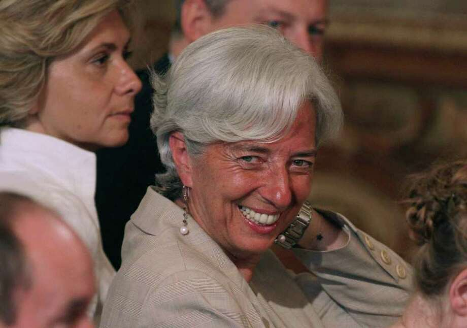 France's Finance Minister Christine Lagarde, smiles during a press conference of France's President Nicolas Sarkozy at the Elysee Palace, Paris Monday, June 27, 2011. French banks are ready to help troubled Greece by accepting a significant debt rollover, President Nicolas Sarkozy said Monday, a move that could push other banks to pitch in to the Europe-wide effort to keep Athens from defaulting. (AP Photo/Michel Euler) Photo: Michel Euler / AP