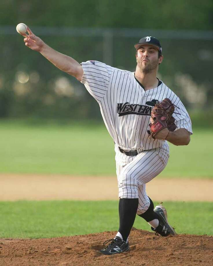 The Westerners' Sam Eagleson delivers a pitch against the North Shore Navigators Tuesday night at Rogers Park. Photo: Barry Horn / The News-Times Freelance