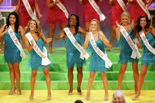 Miss Collegiate San Antonio Selina Affram (center) performs during the opening production during the first night of the Miss Texas Pageant preliminary competition. Photo: LISA KRANTZ / SAN ANTONIO EXPRESS-NEWS
