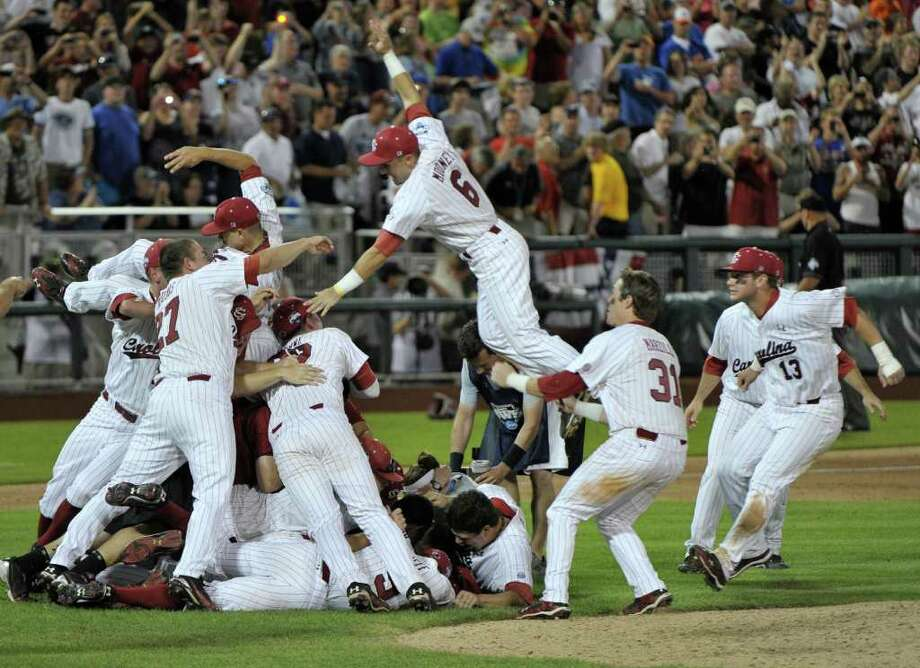 South Carolina players celebrate after beating Florida 5-2 in Game 2 of the NCAA baseball College World Series best-of-three finals, to win the title in Omaha, Neb., Tuesday, June 28, 2011. (AP Photo/Ted Kirk) Photo: Ted Kirk