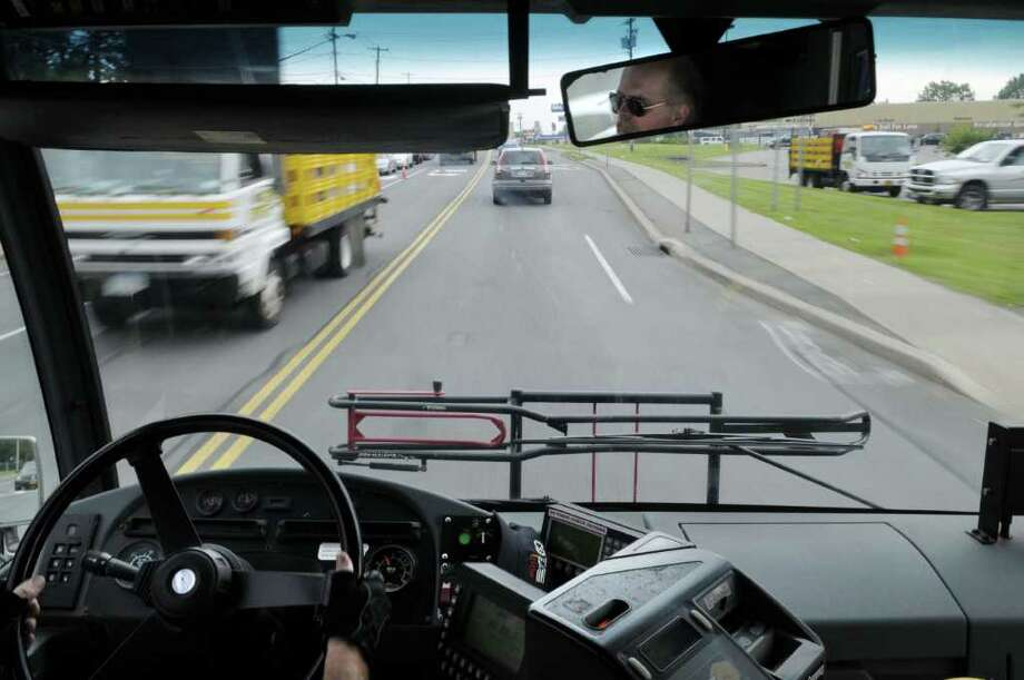 CDTA bus driver Warren Sheldon drives his bus along Altamont Avenue  during his final day on the job on Tuesday afternoon, June 28, 2011, in Rotterdam.  Sheldon, who has been with CDTA for 38 years, also celebrated his 60th birthday on Tuesday. (Paul Buckowski / Times Union) Photo: Paul Buckowski / 00013702A