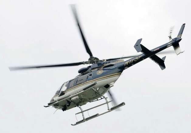 A police helicopter is used to look for missing child Dy'mere Johnson in the Pine Hills Neighborhood in Albany, N.Y. Tuesday June 28, 2011.   (Lori Van Buren / Times Union) Photo: Lori Van Buren