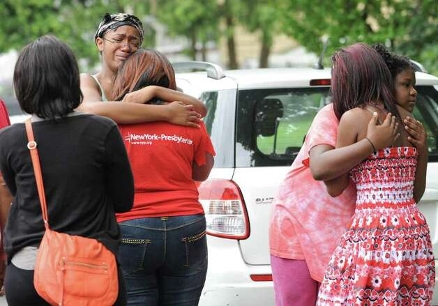 Family members hug while police search for missing child Dy'mere Johnson in the Pine Hills Neighborhood in Albany, N.Y. Tuesday June 28, 2011. From left, Chanell Coleman, Dy'mere's Aunt, Chaniece Coleman, Dy'mere's Aunt, Tracy Coleman, Dy'mere's grandmother, Chyerra Macklin, Dy'mere's cousin, and Charisma Thrasher, Dy'mere's cousin. (Lori Van Buren / Times Union) Photo: Lori Van Buren