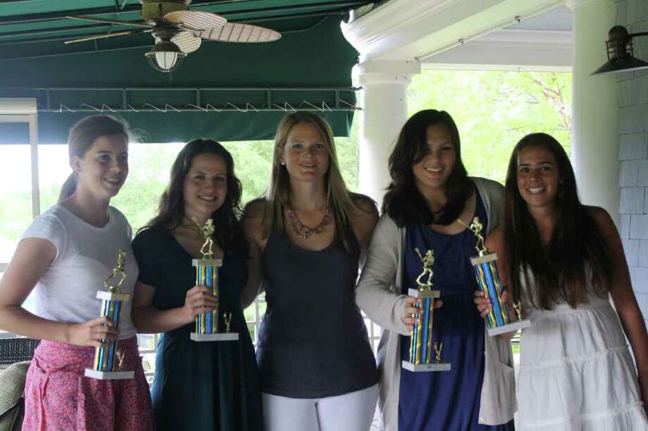 The Weston girls lacrosse team recognizes its players at its banquet. From left, Hannah Hutchins (Offensive MVP), Sara O'Brien (Defensive MVP), Coach Megan Murphy, Sarah DeMartine (Coach's award) and Morgan Moubayed (Rookie of the Year) display their trophies with pride. Photo: Contributed Photo