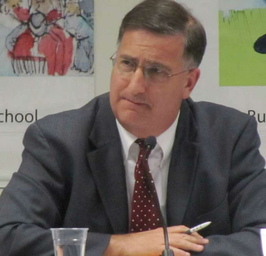 Superintendent of Schools David Title, shown here at Tuesday's Board of Education meeting, was given a $10,000 bonus, but no raise, when the board reviewed his contract after his first year on the job. Photo: Kirk Lang / Fairfield Citizen