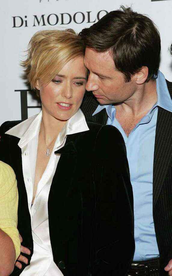 "Actors Tea Leoni and David Duchovny have reportedly split for a second time according to various online reports. Here is the story at Entertainment Tonight: Tea Leoni, David Duchovny splitDirector/actor David Duchovny and wife actress Tea Leoni attend the ""House Of D"" film premiere at Loews Lincoln Square Theater April 10, 2005 in New York City. (Photo by Evan Agostini/Getty Images) Photo: Evan Agostini, Getty Images / 2005 Getty Images"