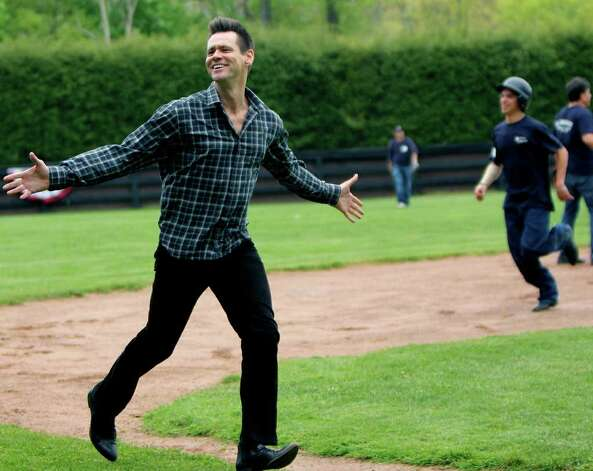 Glenholme milestone  SPECTRUM/Actor-comedian Jim Carrey frolicks on the basepaths, right, during a game of softball played on Parents' Weekend, May 13-14, at Devereux Glenholme School in Washington. Highlighting the weekend, along with visits by Mr. Carrey and fellow comedian Tracy Morgan, was the ceremonial opening of the school's Center for the Arts. The annual Parents' Weekend is held to raise funds for the advancement of the school and provide the opportunity for families to come together as a community and experience many of the school's activities on campus.  Courtesy of Glenholme School Photo: Contributed Photo / The News-Times Contributed