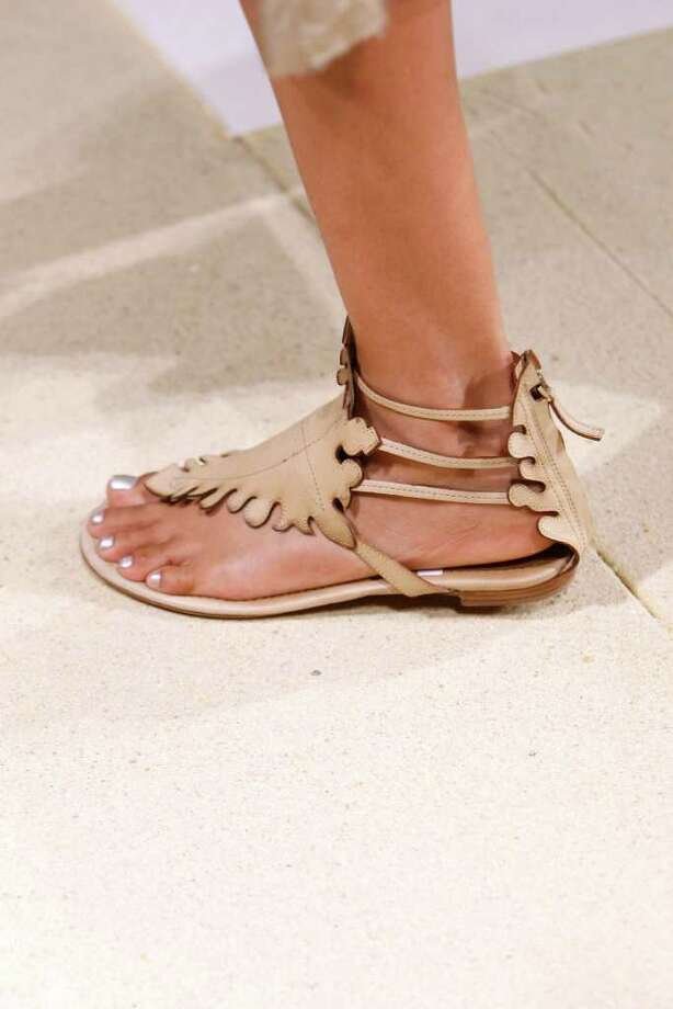 Sculpted flat sandals from Donna Karan for summer 2011.