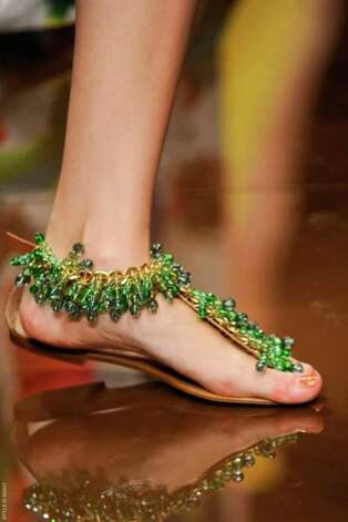 Emerald green beads shimmy on this flat sandal from Love Sex Money's summer collection