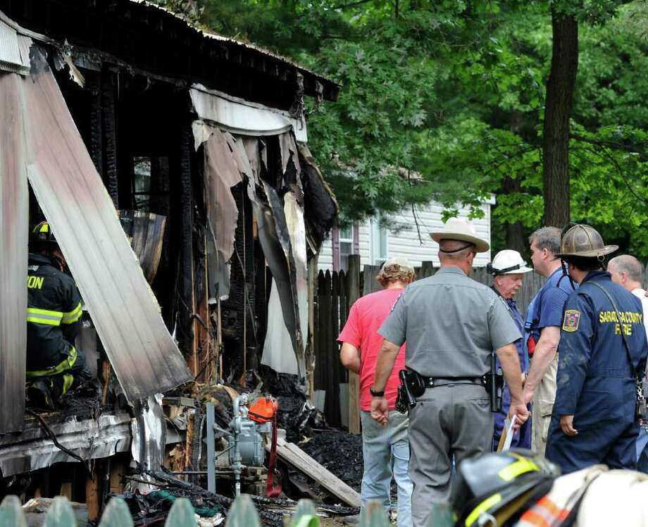 Saratoga County fire investigators search for the cause of a deadly fire early Wednesday morning at Lot 25 in the Saratoga West Trailer Park in Milton.   (Skip Dickstein / Times Union) Photo: SKIP DICKSTEIN
